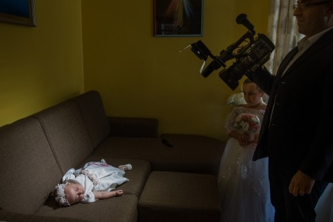 Wedding Photo by Raffaella Arena of Cosenza, Italy of a videography and a baby flower girl.