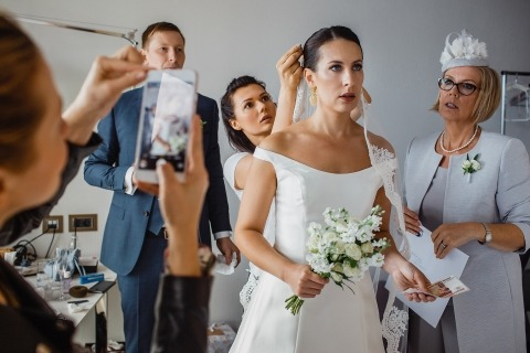 Wedding Photographer Artem Pitkevich of Russia created this image of a bride getting ready with her family.