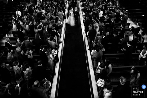 Lima wedding photographer captured this black and white overhead shot of the bride and groom walking down the aisle together after their vows