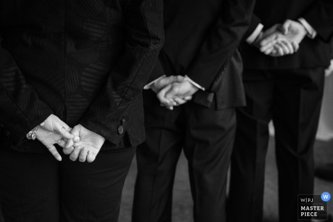 Montana wedding photographer captured this black and white photo of the groomsmen hands clasped behind their backs