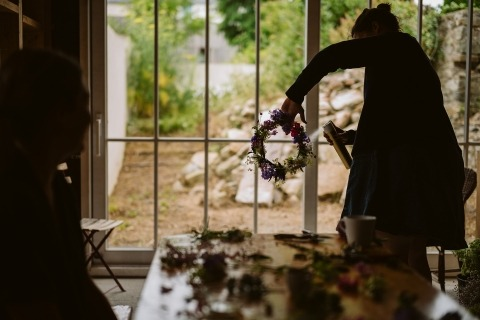 Adam Riley of Cheshire is a Reportage Wedding Photographer and covers the getting ready, like this photo of the flowers getting prepped.