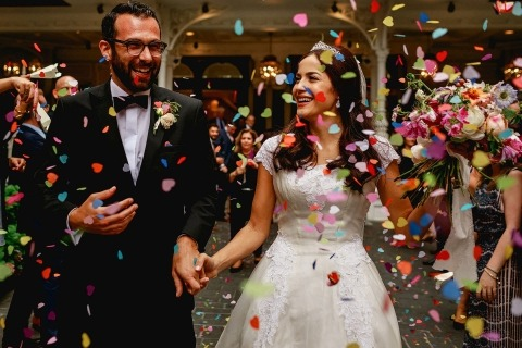 United Kingdom Reportage Wedding Photograph of bride and groom with flower petals by Rahul Khona of London