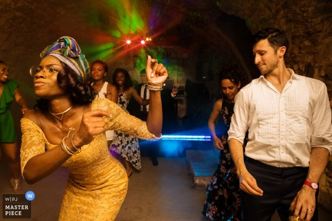 This humorous photo of a wedding guest dancing while another appreciates her moves was captured by a Madrid wedding photographer