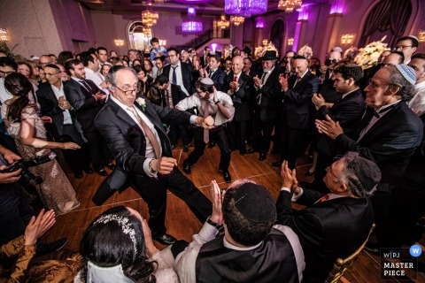 This photo of the father of the groom showing off his best moves on the dance floor was captured by a New Jersey wedding photographer
