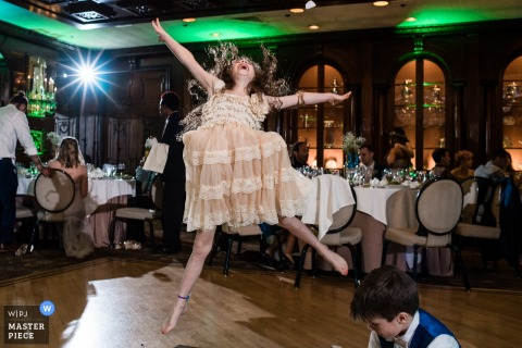 Atlantic City wedding photographer captured this photo of a girl jumping high off the dance floor as she shows off her moves