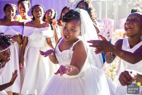 London wedding photographer captured this photo of a flower girl and her friends showing off their dance moves