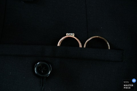 Budapest wedding photographer captured this detail photo of the wedding ring set tucked safely into the grooms jacket pocket