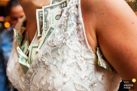 Detail photo of the bride's dress stuffed with money by a New Jersey wedding photographer.