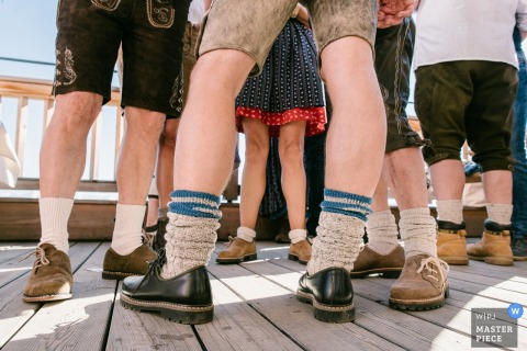 Detail photo of guests wearing dress shoes and lederhosen by a Lower Saxony, Germany wedding photographer.