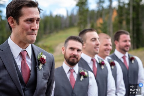 Photo of the groom standing with his groomsmen at the altar by a Montana wedding photographer.