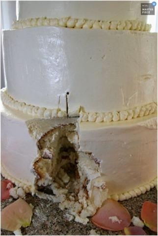 Wedding day cake detail shot of one slice missing