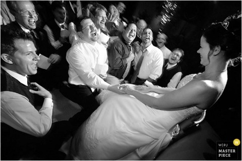 The groom and groomsmen singing to the bride in this black-and-white wedding photo