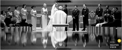 Bride and groom with the entire bridal party in this black-and-white ceremony image with reflections
