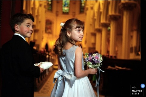 Maryland flower girl and ring bearer are waiting for the word to enter the ceremony in the church