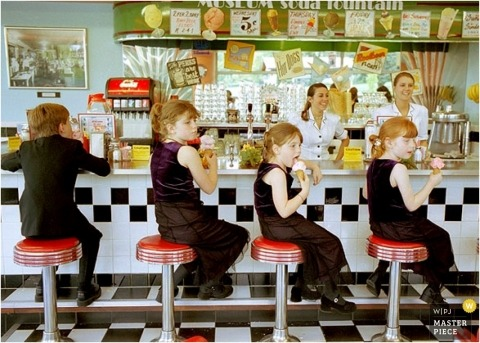 Four children from the wedding enjoy ice cream treats at the bar