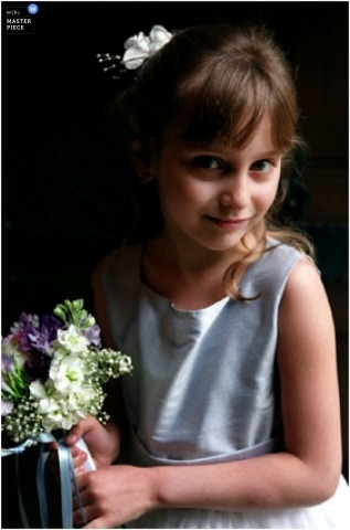 Vertical color image of the flower girl and her bouquet