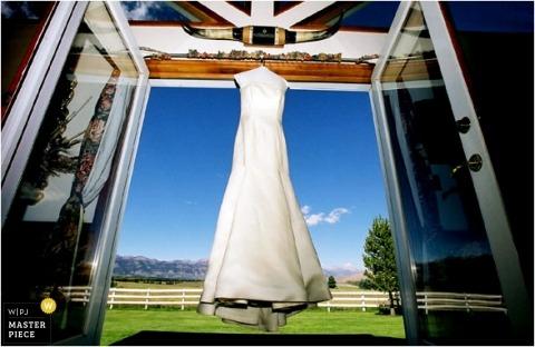 the dress of a KY bride hangs in open doorway