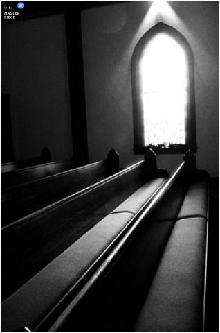 Vertical church pew detail with window.