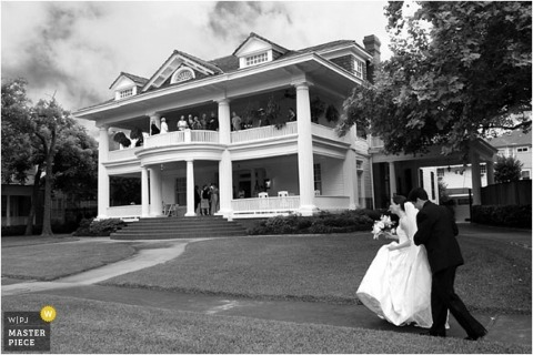The bride is arriving on wedding day in this black-and-white image