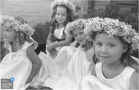 Four flower girls outdoors in photo