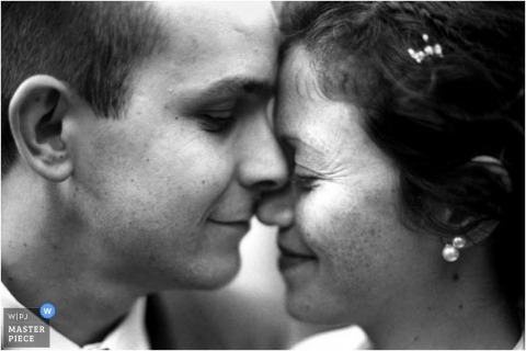 intimate moment shot with bride and groom faces