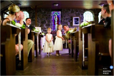 CO flower girls holding their baskets in the church waiting for the bride