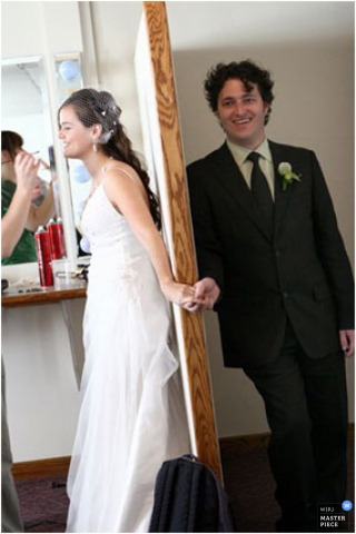 Image of a Detroit bride and groom holding hands with a door between them.