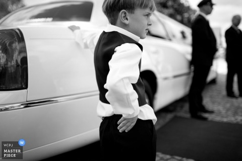 Lower Saxony wedding image of a boy with limo in black and white,