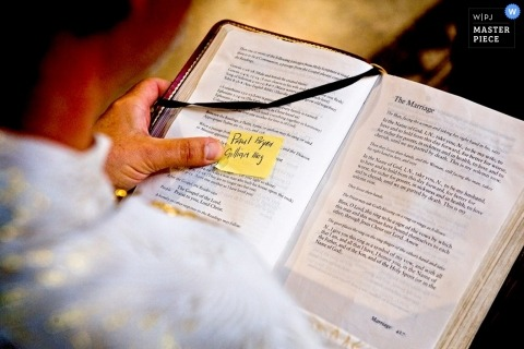 Rome Wedding Detail image of a opened Bible with a yellow Post-it note attached to a page
