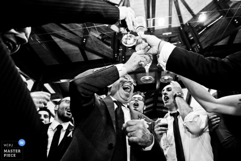 Venice Wedding Reportage Photos | Image contains: drinks toasting reception party men