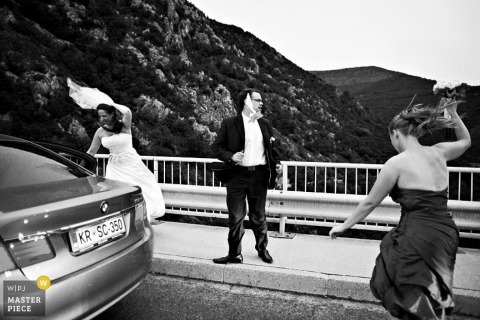 Ljubljana Slovenia wedding photography |  windy lookout car bride groom veil blowing