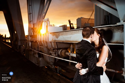 Lower Saxony wedding image of a bride and groom kissing at sunset