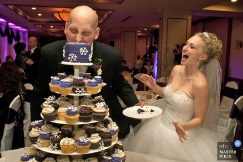 Ottawa Wedding Photographer | Image contains: cake cutting expressions bride groom cupcakes purple reception