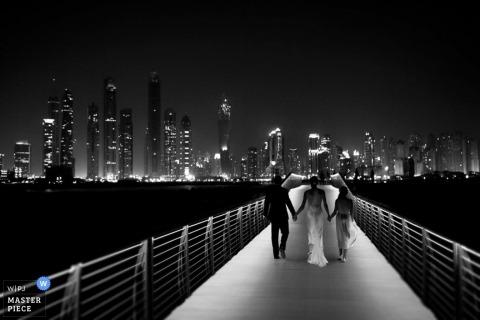 Toronto Wedding Photographer | Image contains: black white night walk skyline bride groom
