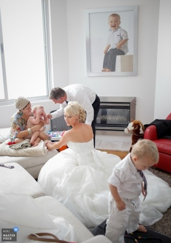 Sydney Wedding Photojournalism | Image contains: bride getting ready kids dressing up white suits gown hair