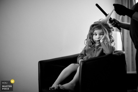 Hertfordshire Wedding Reportage Photography | Image contains: flower girl hair curling iron bored getting ready