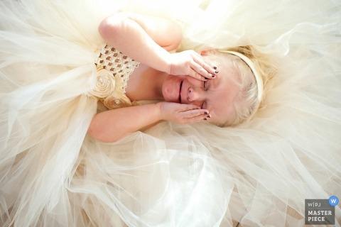 Jacksonville Wedding Photojournalism | Image contains: flowergirl dress white color crying