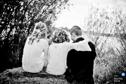 Netherlands Documentary Wedding Photographer - ZH | Image contains: sitting relaxing wedding day