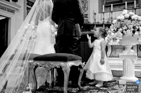 Italy Documentary Wedding Photographer | Image contains: bride groom altar flowergirl ceremony black white