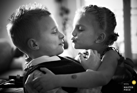 Malopolskie Wedding Photographer | Image contains: kids chilren kissing tux dress