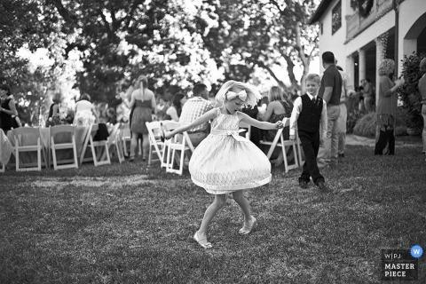 San Antonio,TX Wedding Photographer | Image contains: children dancing little girl dress black white boy