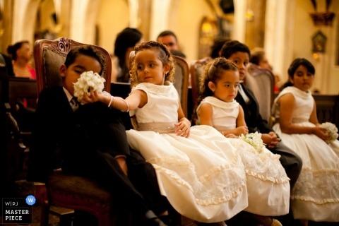 Paraná Documentary Wedding Photographer | Image contains: flower girls boys flowers smelling children kids ceremony dresses