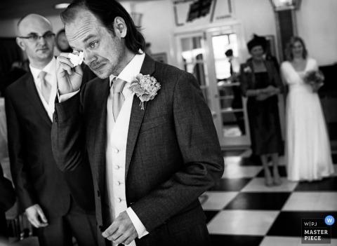 Devon Documentary Wedding Photographer   Image contains: UK groom tears ceremony bride
