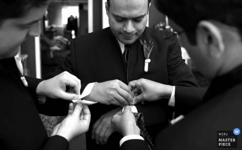 Santa Barbara CA Wedding Photojournalism | Image contains: groom cufflinks groomsmen getting ready suits tux black white