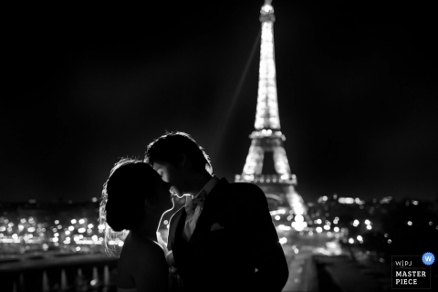 Toronto Wedding Photographer | Image contains: night portrait bride groom kissing black sky
