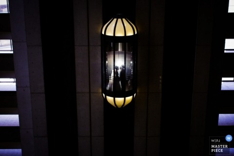 Seattle wedding photos | bride groom riding elevator night light