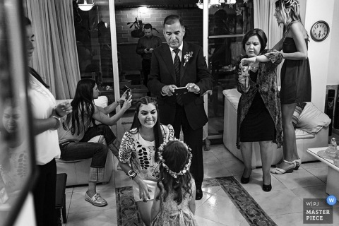 Scotland wedding photojournalist | Edinburgh image of the flower girl getting some attention before her big debut