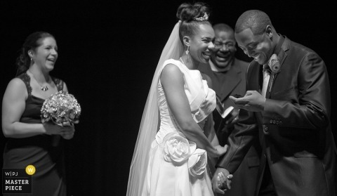 Atlanta wedding photographer captured this black and white photo of the bride smiling as the groom reads her his vows