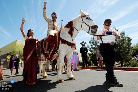 Phoenix wedding photographer captured this photo of the groom riding on a horse at the Arizona wedding ceremony