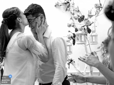 Bucharest wedding photography in black and white of the bride kissing the groom on the forehead at the wedding reception